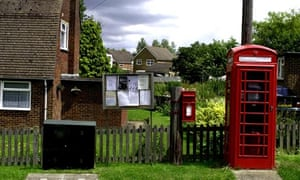 Phone box, letter box in background