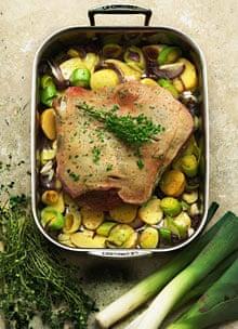 New season roast lamb on leeks and potatoes