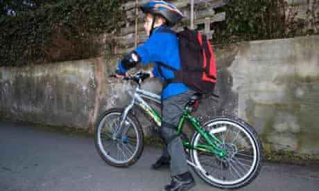child cycles to school