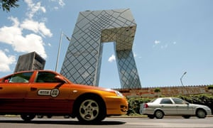 Traffic moves past the CCTV Tower in Beijing, China, on Tues