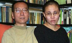 Chinese dissident Liu Xiaobo (L) and his wife Liu Xia