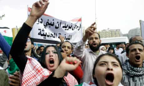 Syrian protestersin front of the Arab League headquarters in Cairo