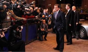 David Cameron faces the press at the EU summit