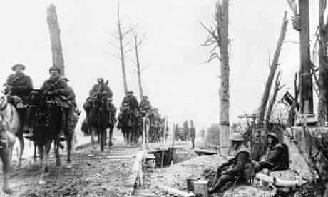 British cavalry cross a temporary bridge, circa 1915.