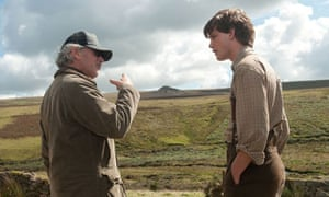 Steven Spielberg directs Jeremy Irvine on location in Devon during the filming of War Horse.
