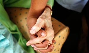 carer-holding-hands-with-elderly-person