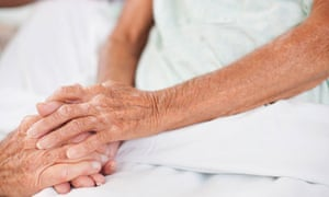 old-couple-holding-hands-close-up