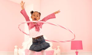 Young Girl Hula Hooping on Her Bed
