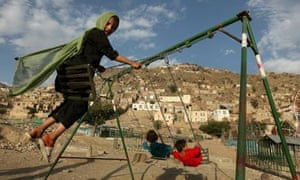 kabul girl on swing