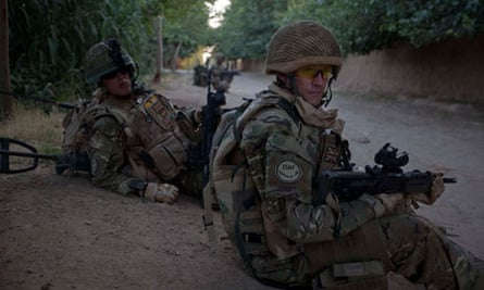 A British patrol returns to camp in Nad-e Ali district of Helmand province