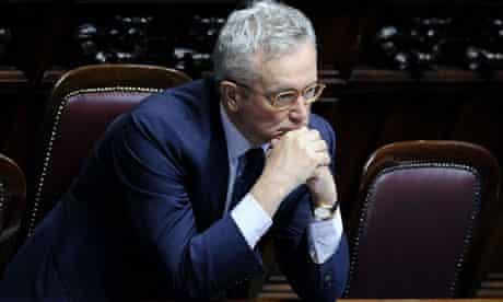 Glum-looking Italian finance minister Giulio Tremonti rests head on elbows