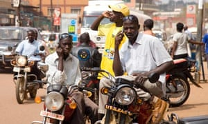 Africa mobile phones in use on the streets of Kampala, Uganda