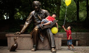 Children play on a statue of Hans Christian Andersen in New York's Central Park
