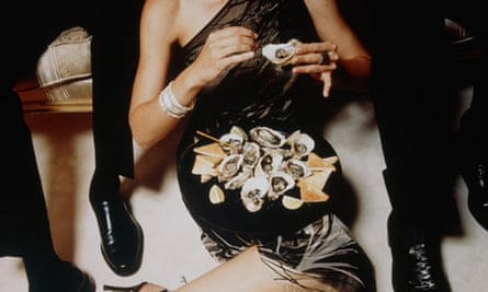 Woman in Cocktail Dress Eating Oysters on Floor