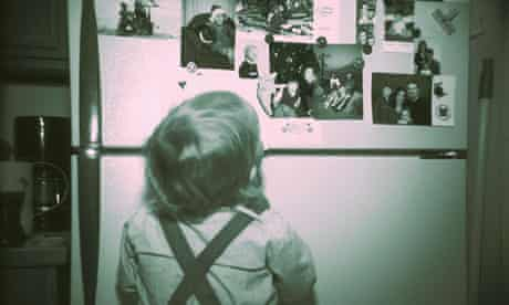 Boy Looking at Refrigerator Pictures