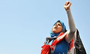 A woman protests outside a Cairo court where a former minister was on trial.