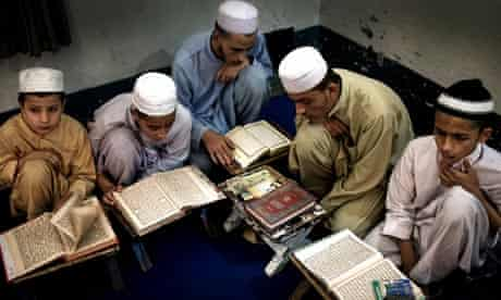 Children studying at a madrasa in Peshawar