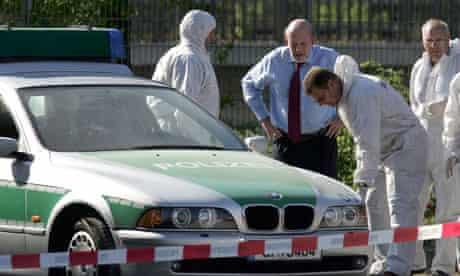 Police forensics officers examine murder scene