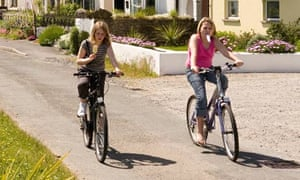 Children cycling on seafront road