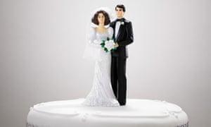 Bride and bridegroom figurines on a wedding cake