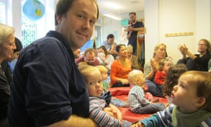 Richard Orange with his daughter at playgroup in Sweden
