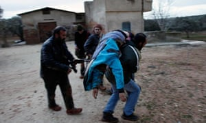 syrian-rebel-evacuates-wounded-comrade