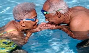 Senior Couple Flirting in Pool