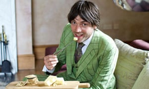 Alex James eating cheese and crackers