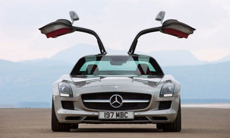 Car review mercedes benz sls amg technology the guardian for Mercedes benz with wing doors