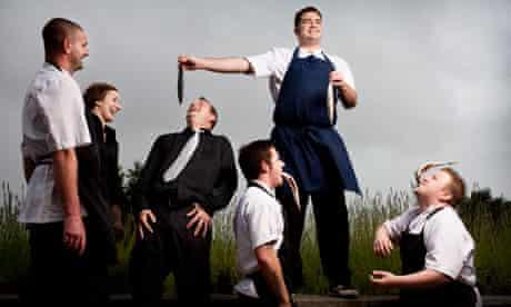 nathan outlaw feeding fish to staff