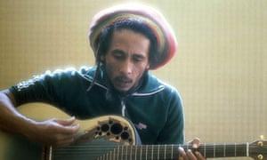 Bob Marley playing guitar