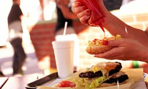 woman-squeezes-kechup-burger