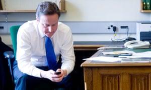 David Cameron writes text on mobile phone