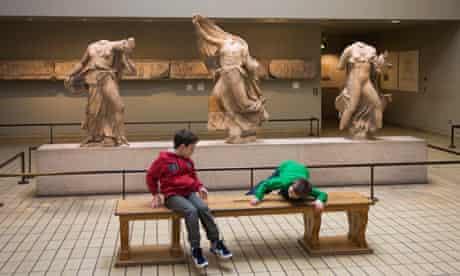 Children play near Parthenon marbles