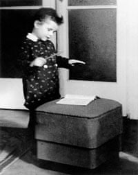 Mariss Jansons playing conductor, aged 3.