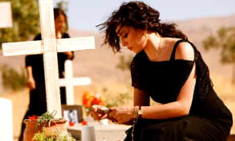 Nadine Labaki at a graveside in Where Do We Go Now?
