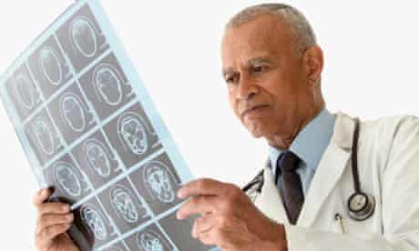 Male doctor examining x-rays