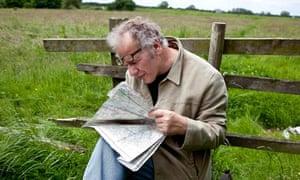 Nick Papadimitriou reads a map on the Scarp