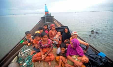 Rohingya Muslims trying to cross the Naf river into Bangladesh