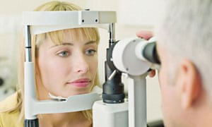 Eye doctor examining woman's vision