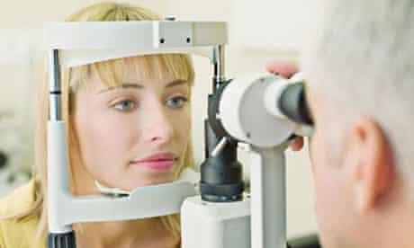 Eye doctor examining woman's vision