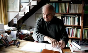 File photo of Polish writer and journalist Ryszard Kapuscinski poses in Warsaw