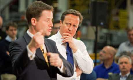 British Prime Minister David Cameron (R)