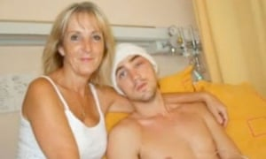 Maggie Hughes with son Robbie in hospital