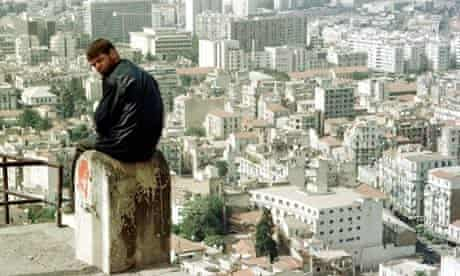 Algiers: a man sits overlooking the city