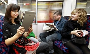 Readers on an underground train