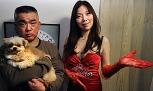 Sex counsellor Ai Aoyama with a client and her dog