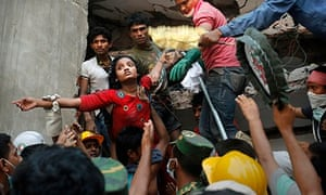 A young woman with arms outstretched being rescued from the rubble of Rana Plaza