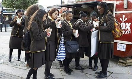schoolgirls at the box chicken van