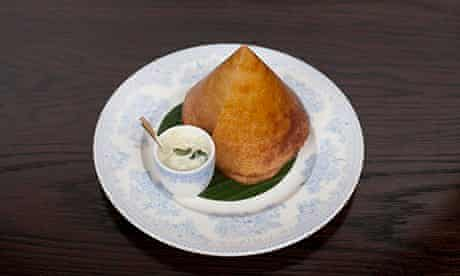 Pyramid-shaped duck dosa on round plate at Gymkhana